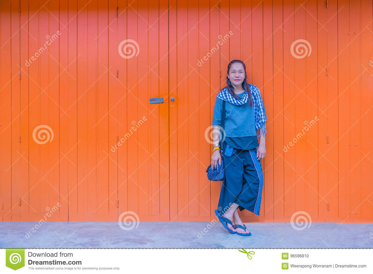 Abstract soft focus the woman standing in front of the old wooden wall with the natural light.