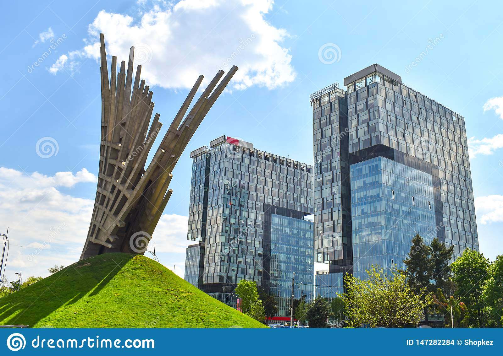 Abstract statue in front of the City Gate Towers, two class A office buildings located in Press Square of Bucharest, capital of