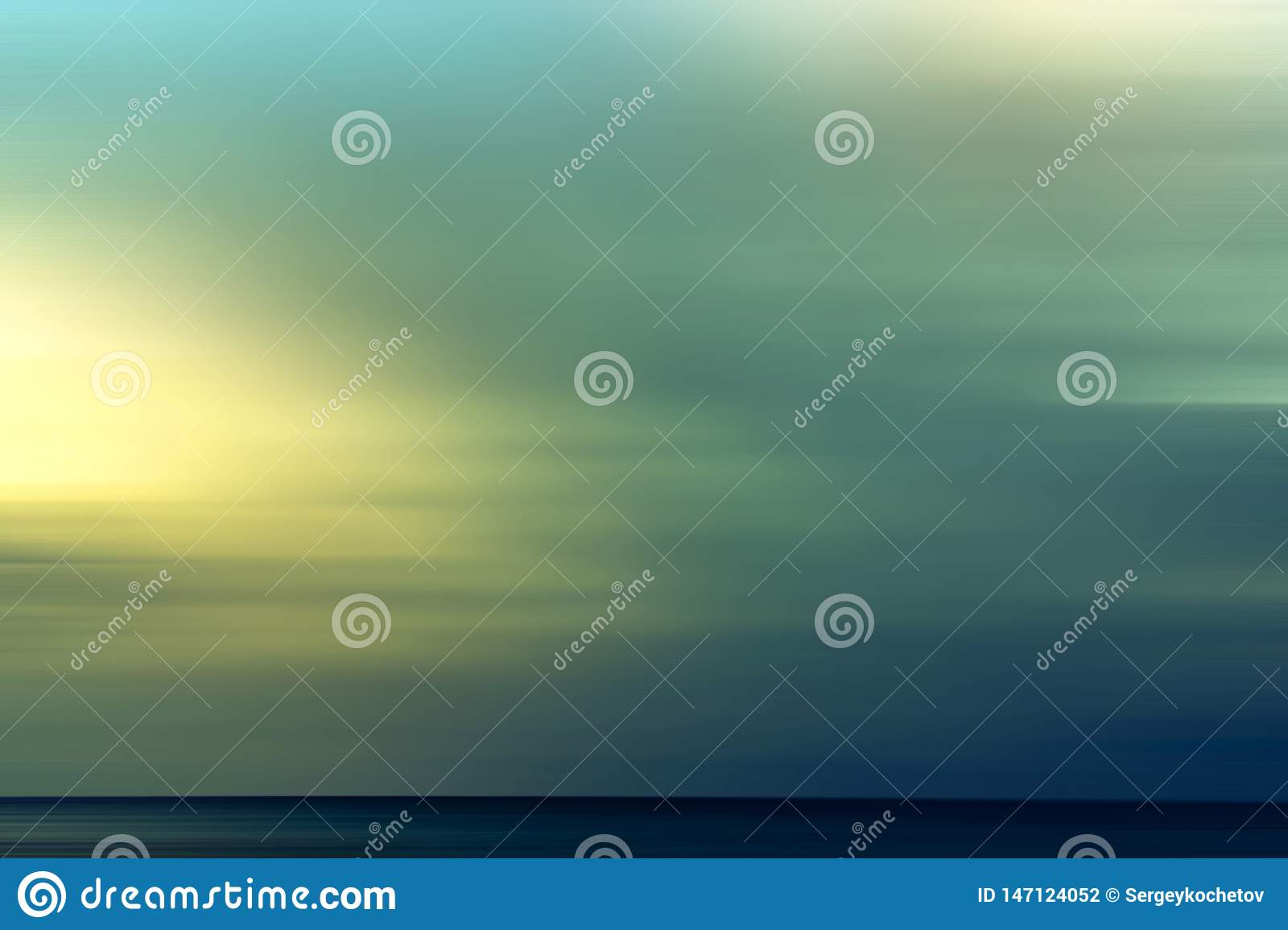 Abstract summer background with the setting sun over the sea