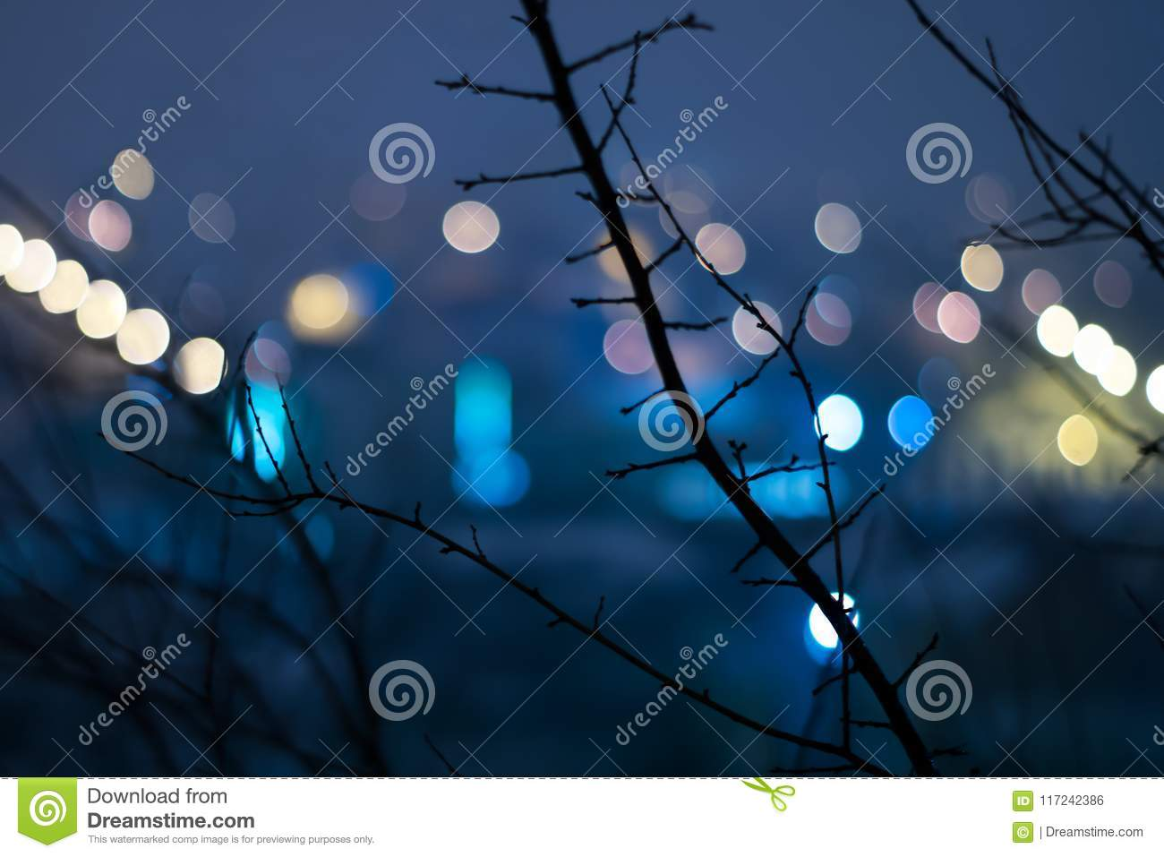Abstract urban night light bokeh, defocused background.