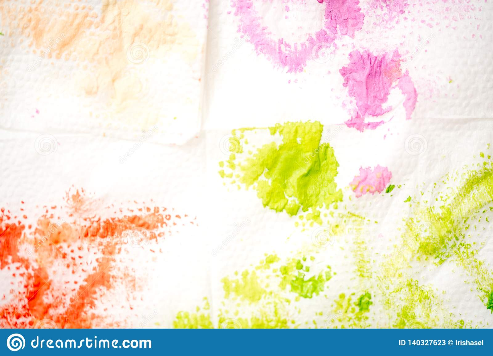 Abstract watercolor hand painted background. Green stain of paint on a white napkin