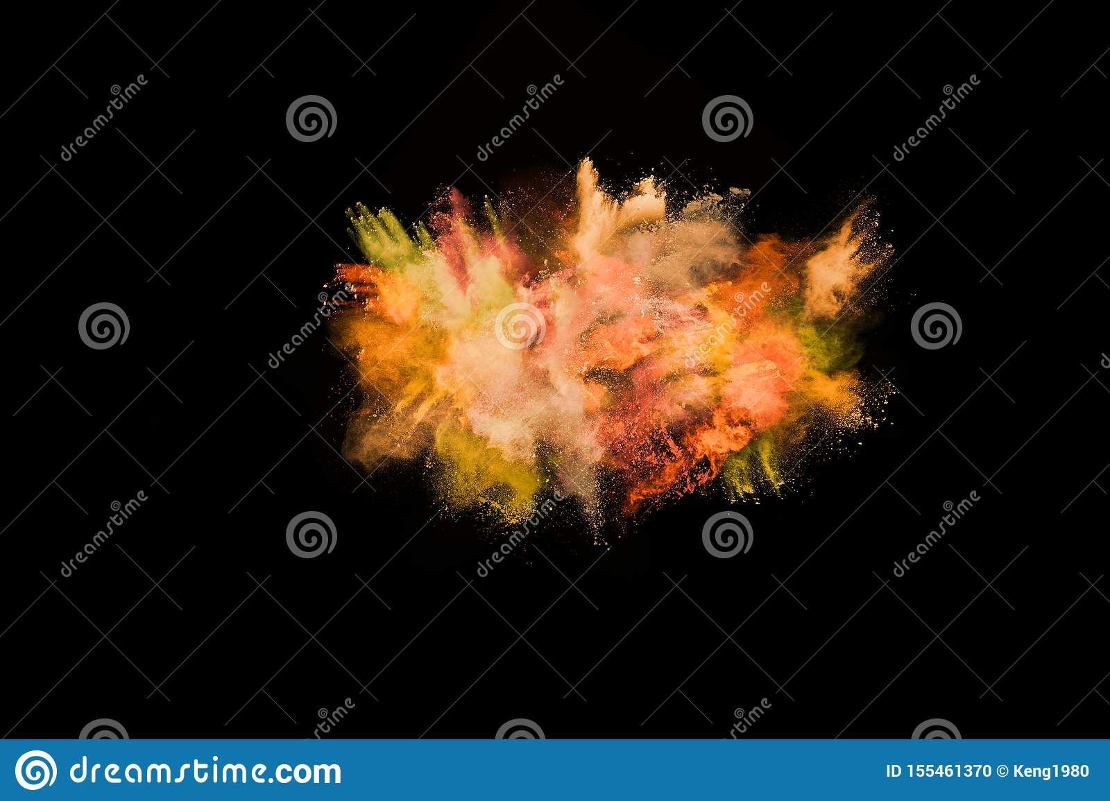 Yellow color powder explosion on black background