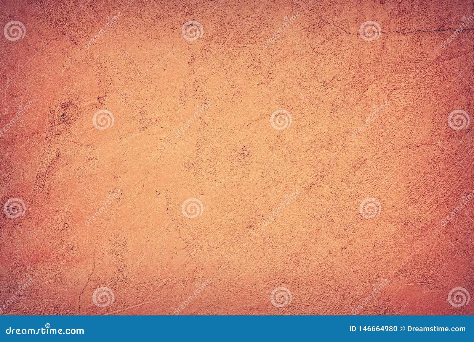 Abstracte achtergrond, de muur waarop het oranje pleister