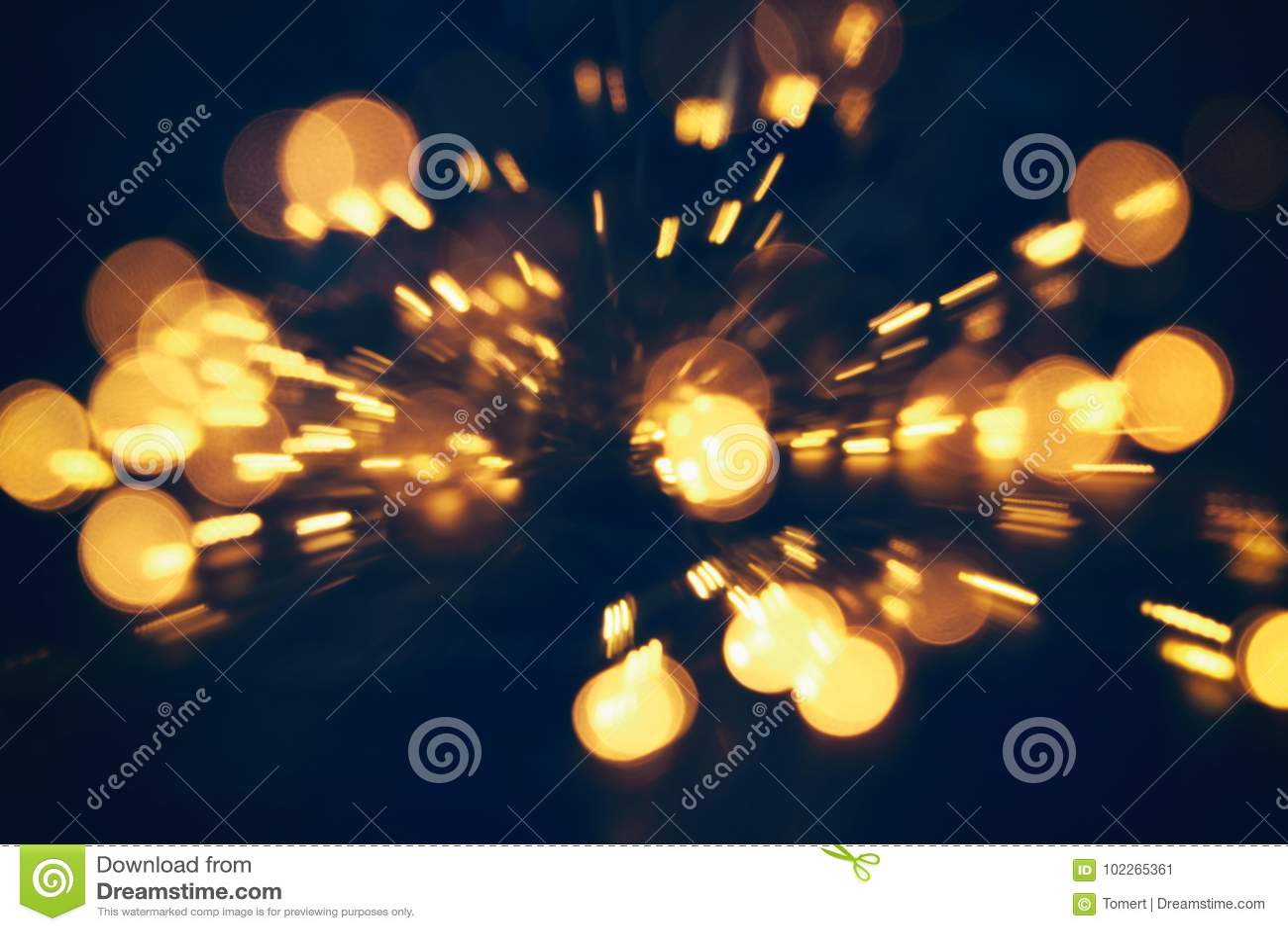 Abstracte bokehachtergrond van gouden lichte die uitbarsting van bokehmotie wordt gemaakt