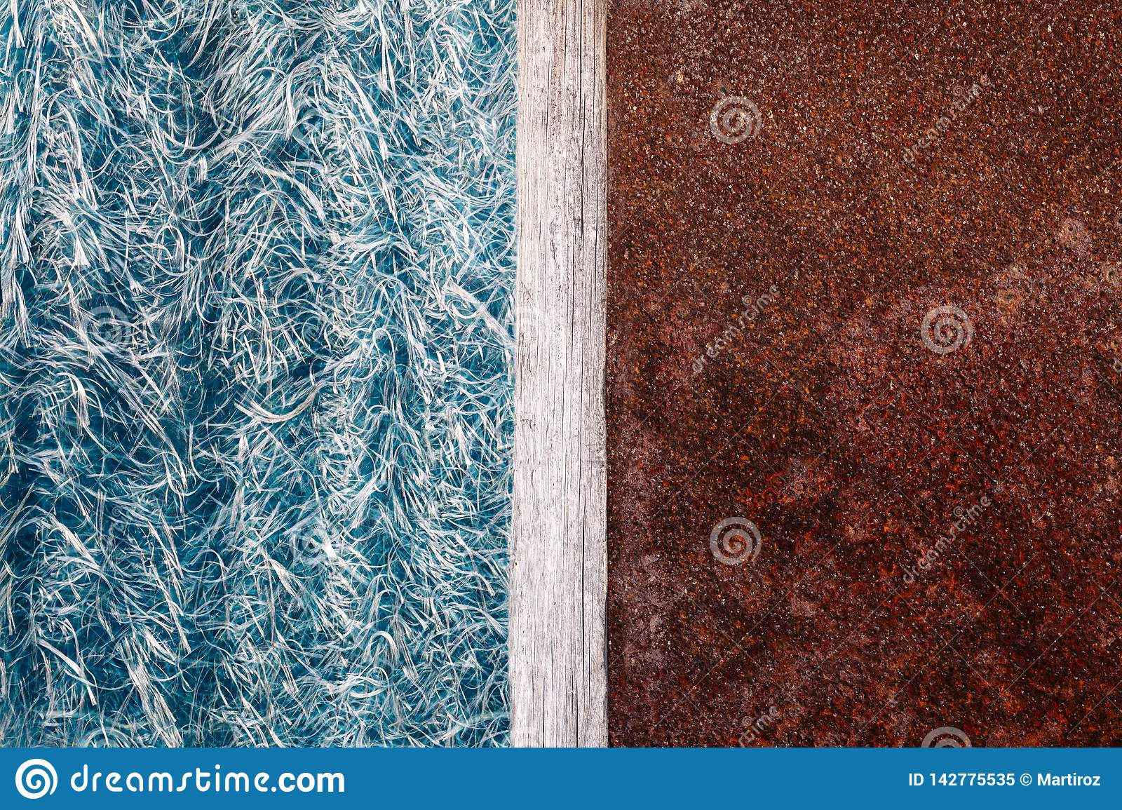 Abstraction of blue textolite slate, background in half with a rusty metal plate and a dividing strip of wood