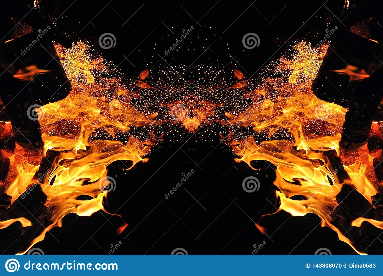 Abstraction, burning fire with sparks. Mystical type of butterfly or monster. Horizontal reflection