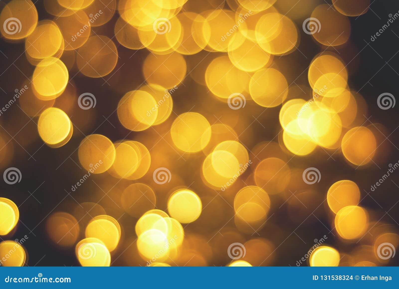 Abstrakcjonistyczni boże narodzenia grżą lekkiego świętowania bokeh tło z de skupiającą się światło teksturą