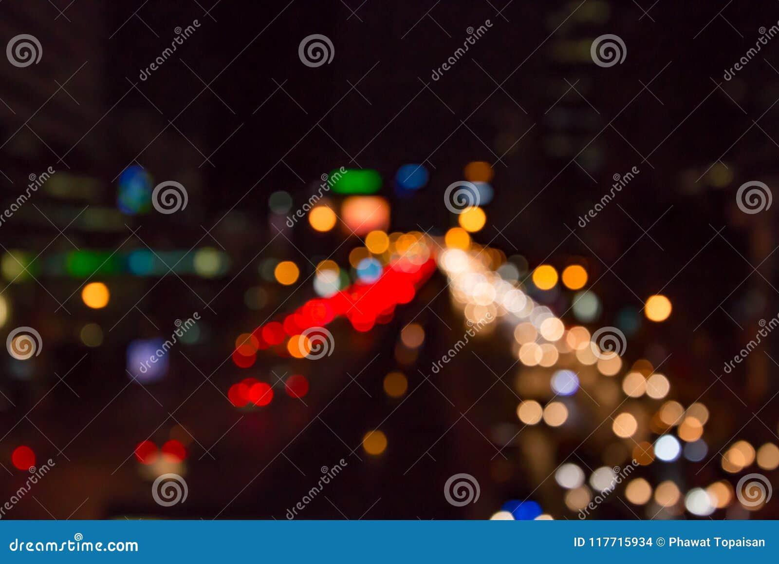 Abstrakcjonistyczny miastowy miasto nocy światła bokeh, defocused tło