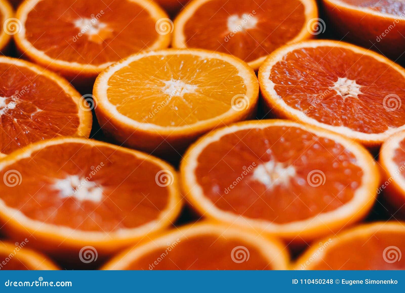 Abstrakt red för fotografi för grapefrukten för frukt för bakgrundscitrusclosen skivar upp studion Närbild
