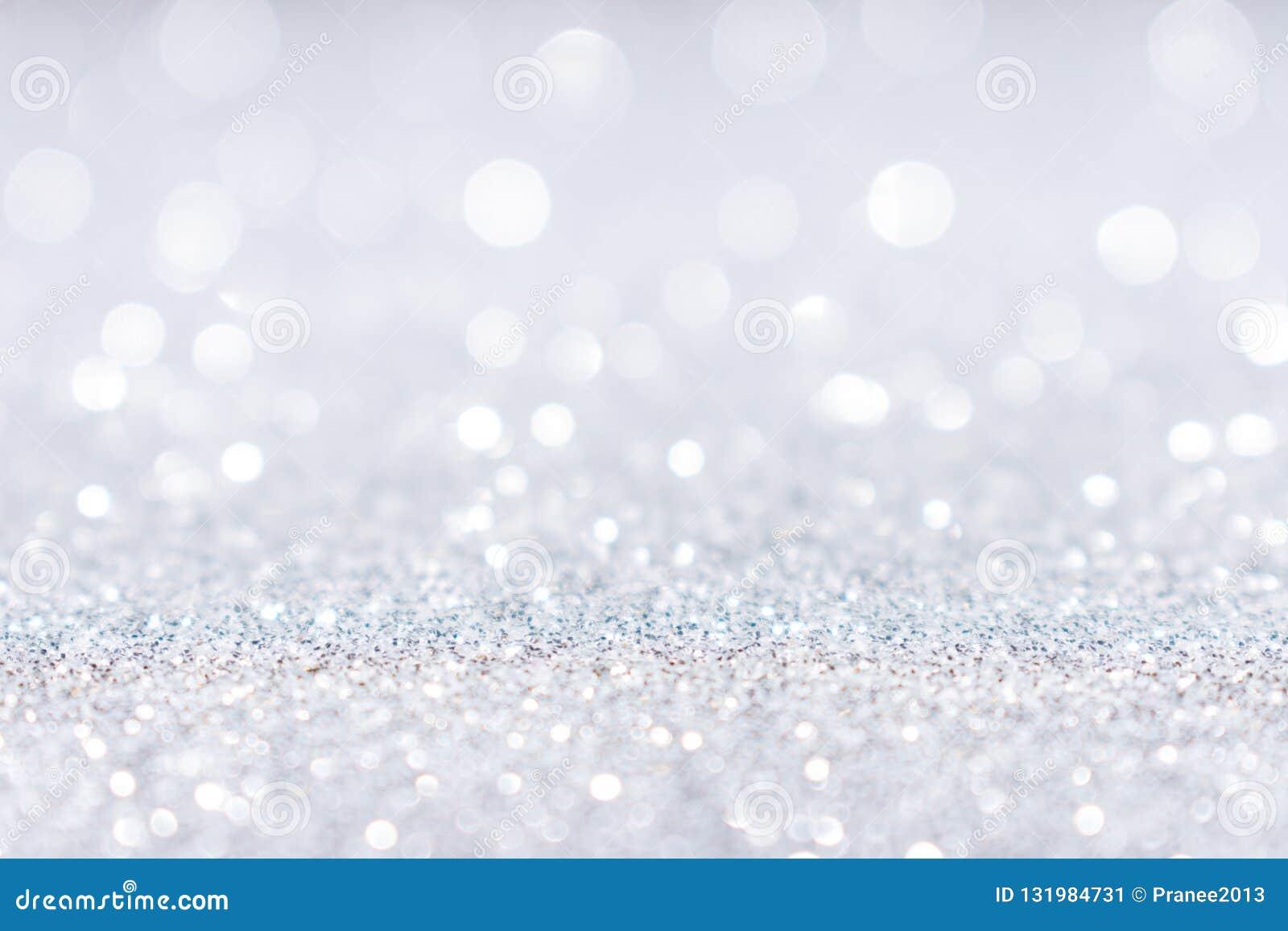 Abstrakt vit silver blänker gnistrandebakgrund