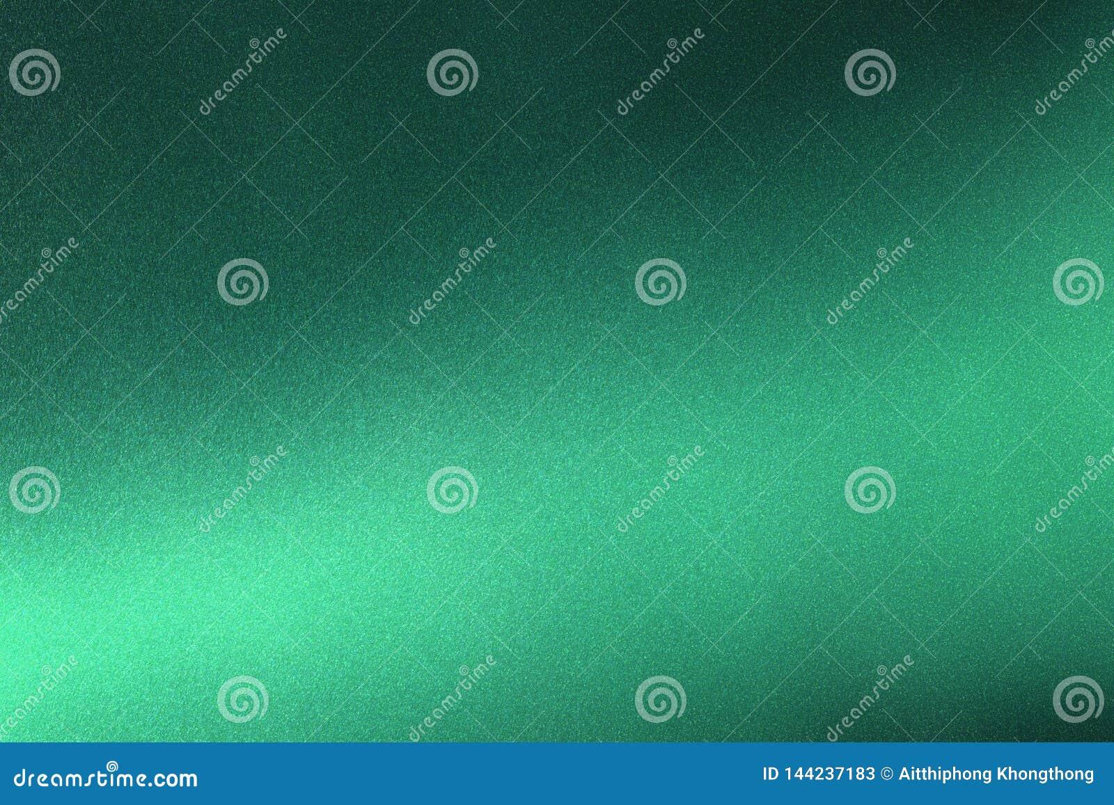 Abstrakter Beschaffenheitshintergrund, helles Glänzen auf rauem dunkelgrünem metallischem