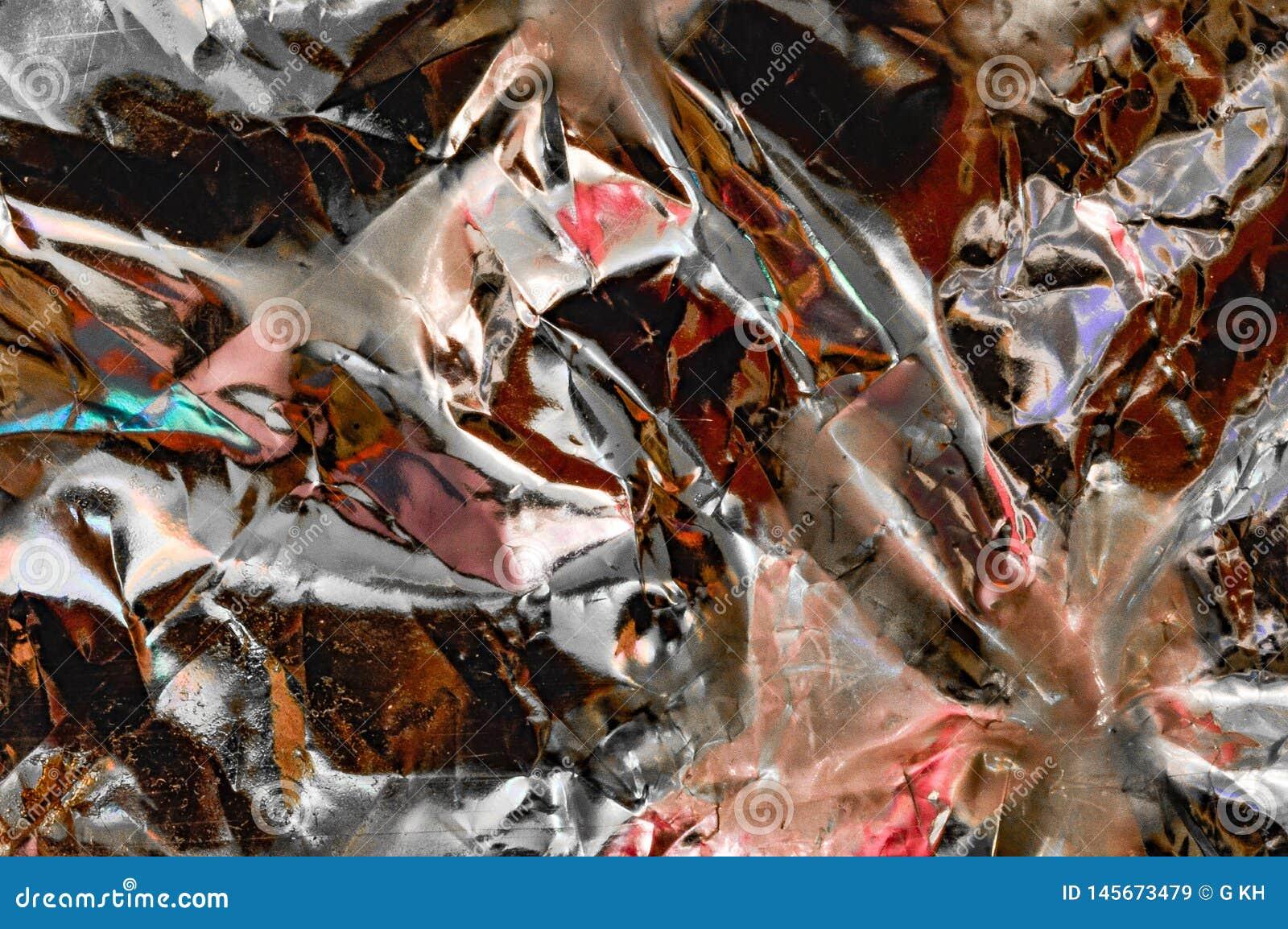 Abstrakter Hintergrund mit metallischem Muster der Originalität in Mehrfarben