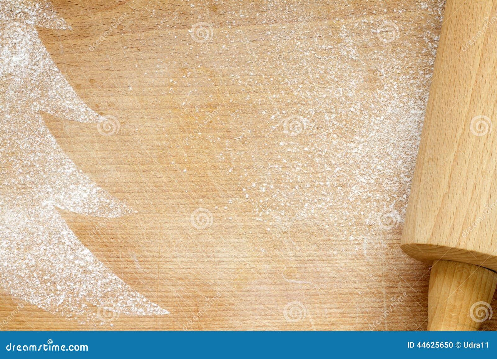 Abstrakter Weihnachtslebensmittel-Schutzträgerhintergrund auf Weinlesebrett