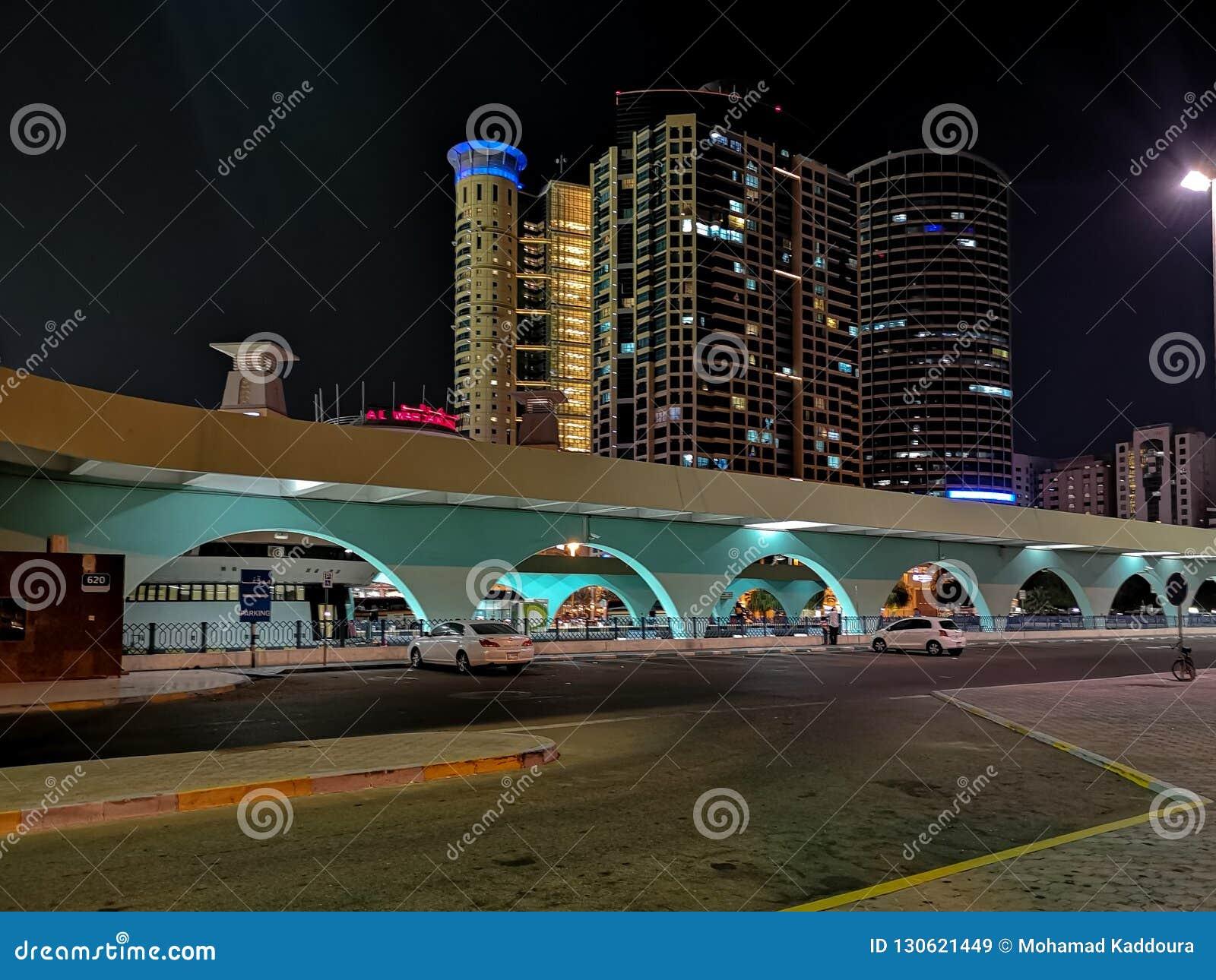 Abu Dhabi City Bus Station At Night - Al Wahda Mall Editorial Stock