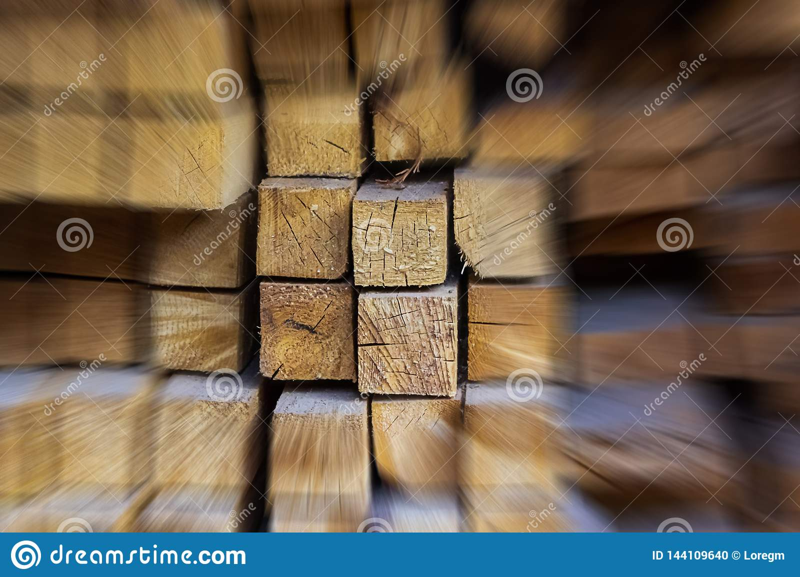 Acceleration abstract wooden background group of beams among blurry building materials highlighted set close-up base