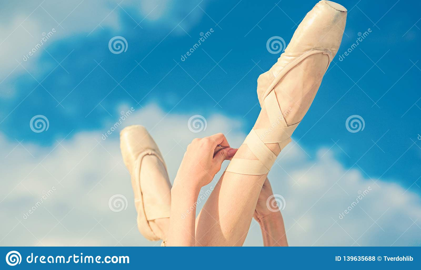Accentuating the beauty. Ballet slippers. Ballerina shoes. Ballerina legs in ballet shoes. Feet in pointe shoes. Pointe
