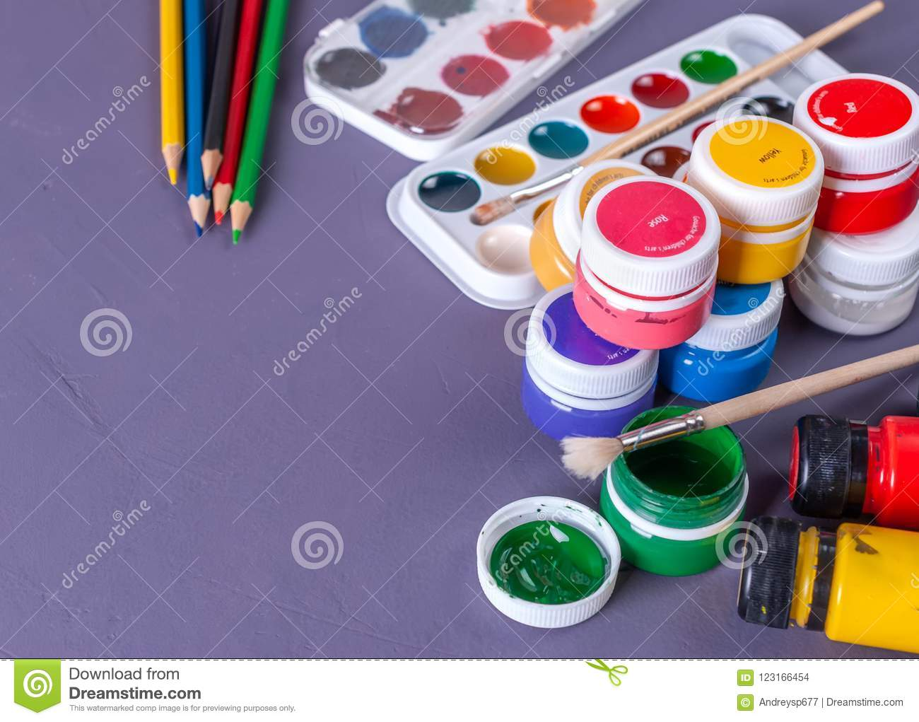 accessories for painting paints brush and colored pencils stock
