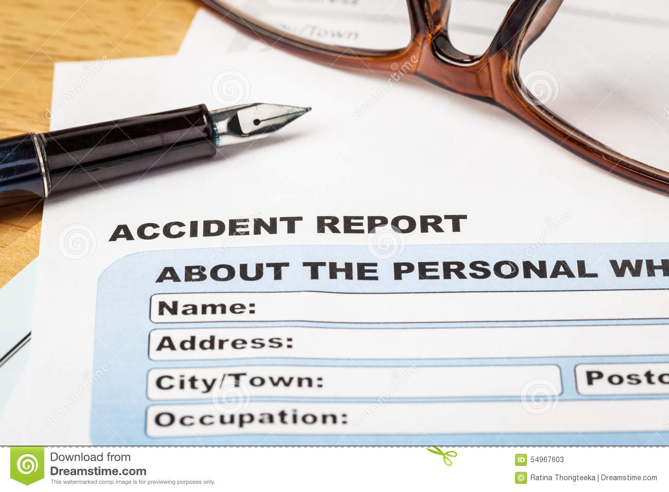 accident report application form and pen on brown envelope and e accident report application form and pen on brown envelope and e