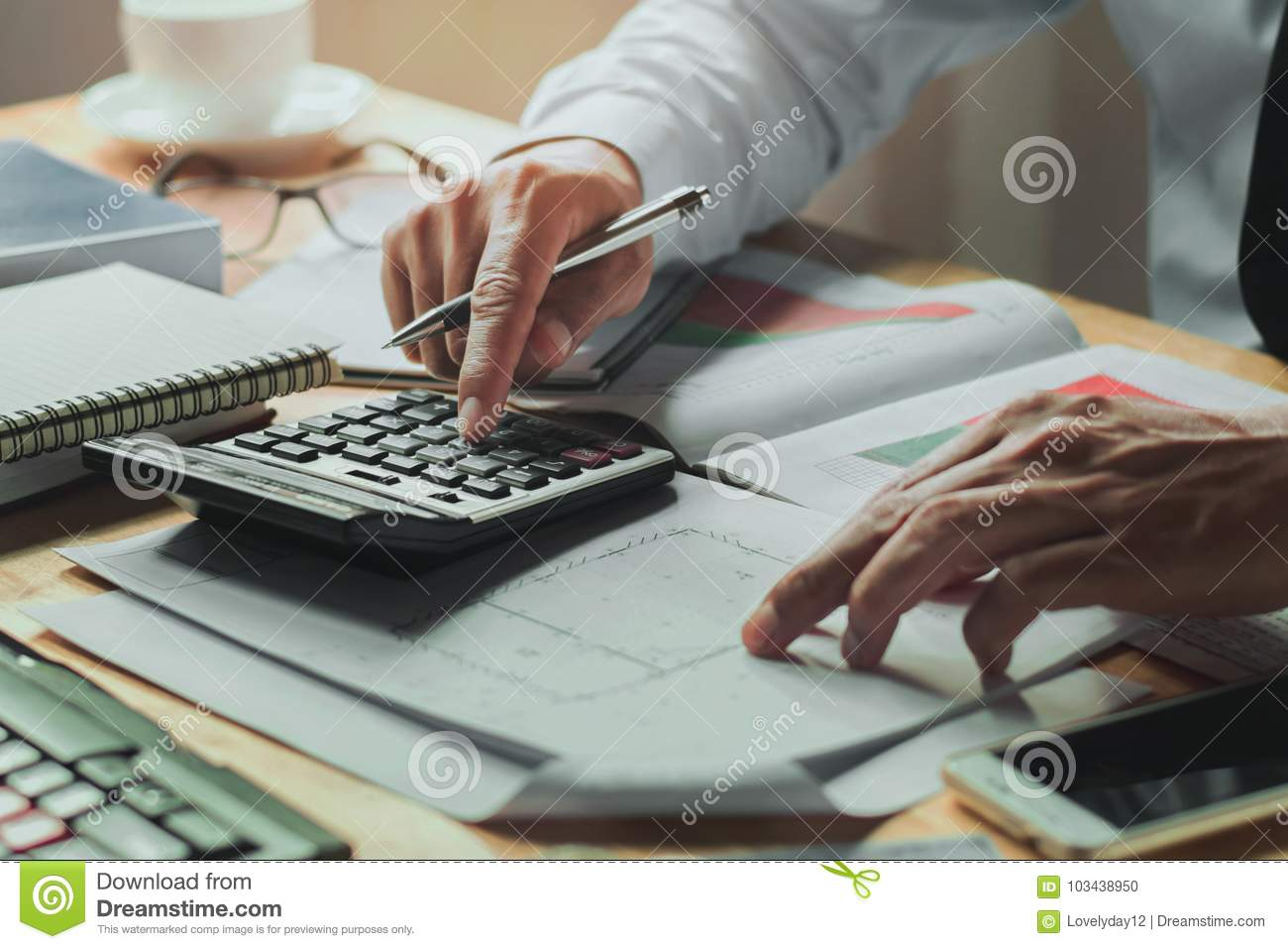 accountant working on desk office with using a calculator finance accounting concept