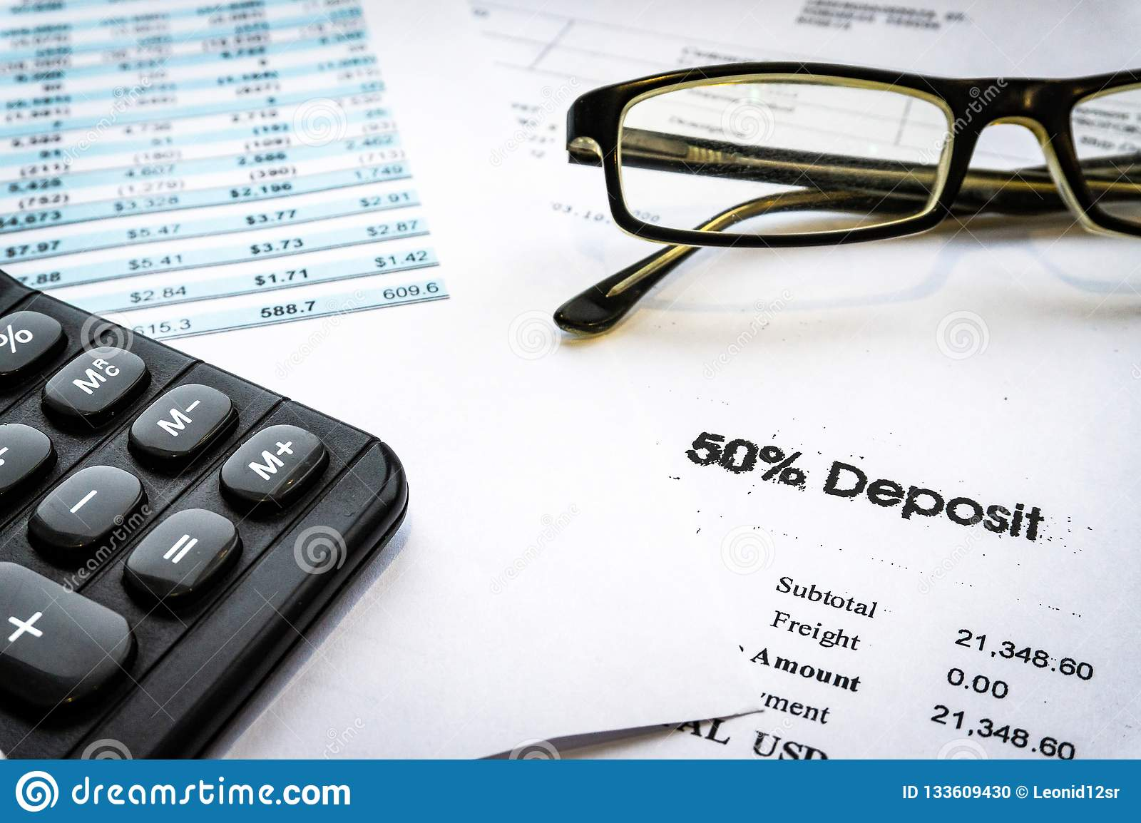Accounting business concept. Calculator with accounting report and financial statement