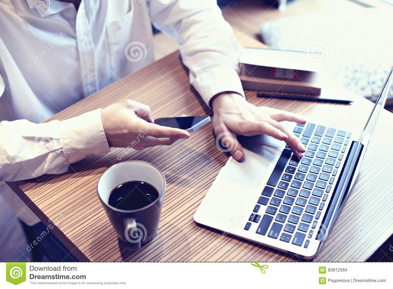 accounting-business-man-use-laptop-computer-mobile-phone-cafe-writing-business-plan-drinking-coffee-coffee-83812564.jpg