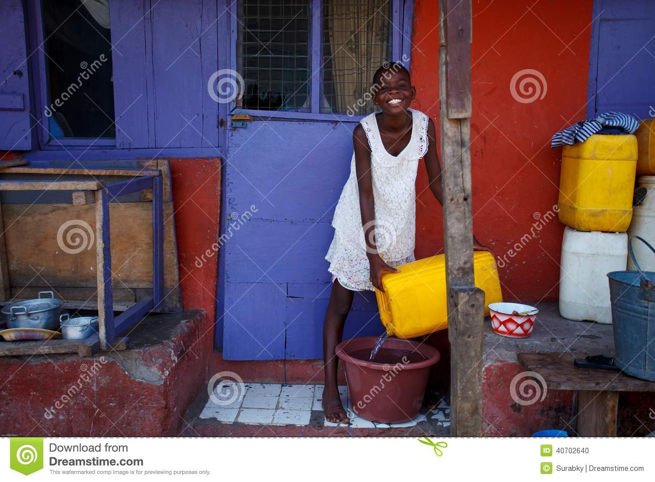 ACCRA, GHANA � MARCH 18: Unidentified African girl pouring water