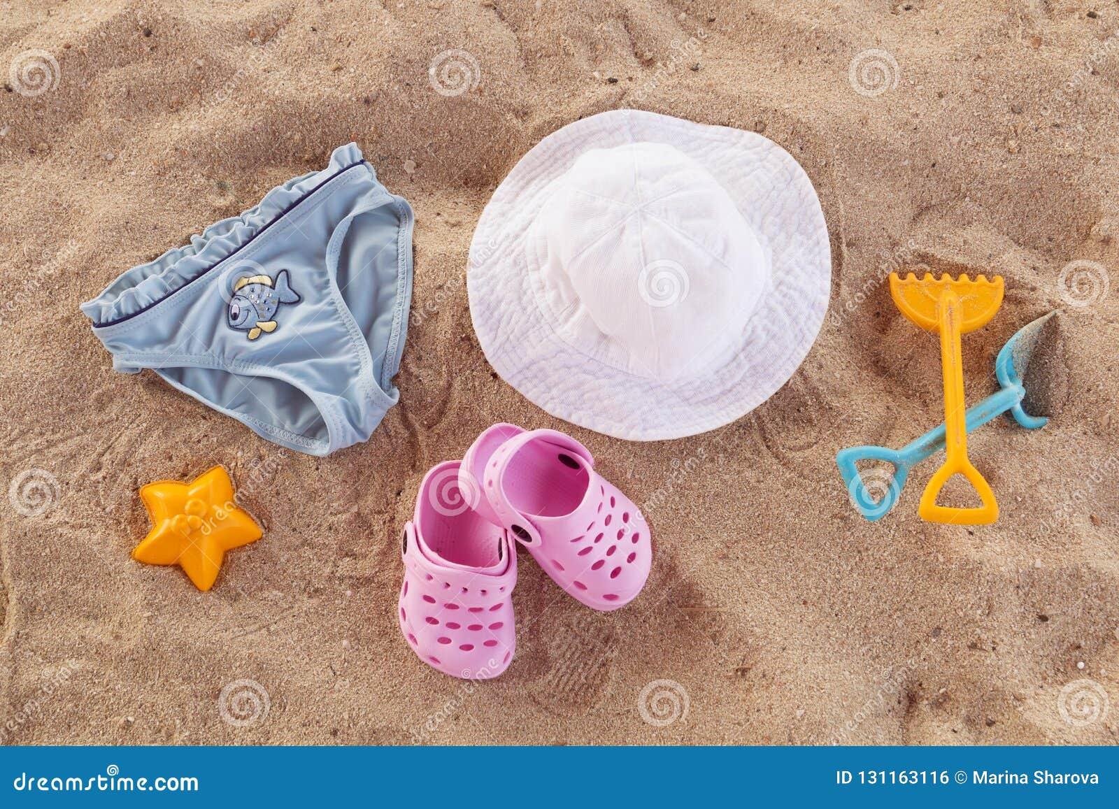 Acessórios da piscina para a configuração do plano das crianças A opinião superior as crianças encalha artigos na areia Falhanços