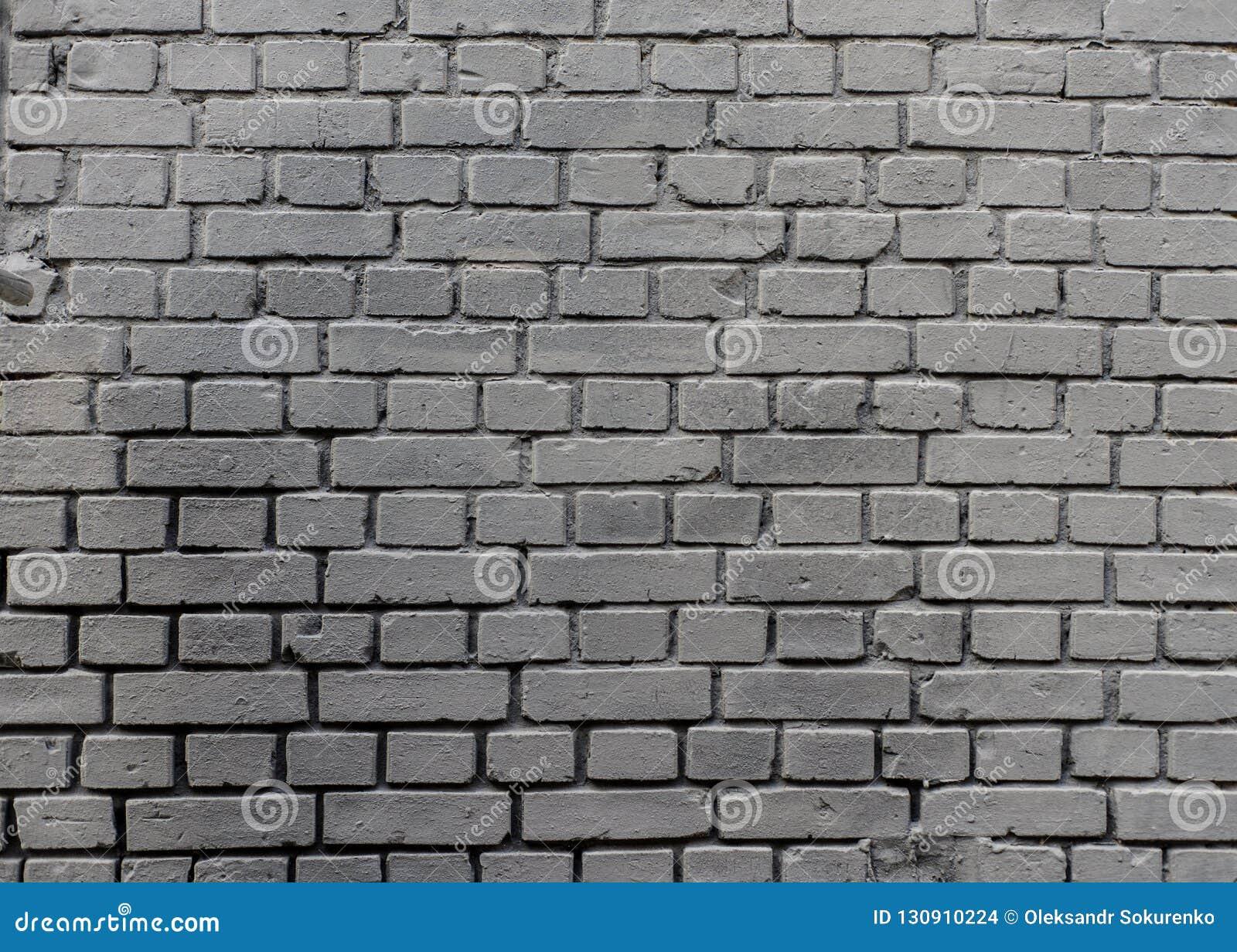 Achtergrond van de Grunge de industriële grijze geschilderde bakstenen muur in Kyiv, de Oekraïne