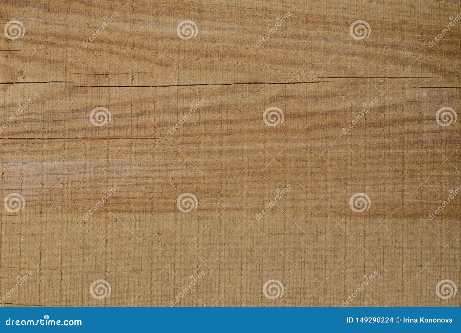 Achtergrond van vers gesneden bruine houten raad met barsten