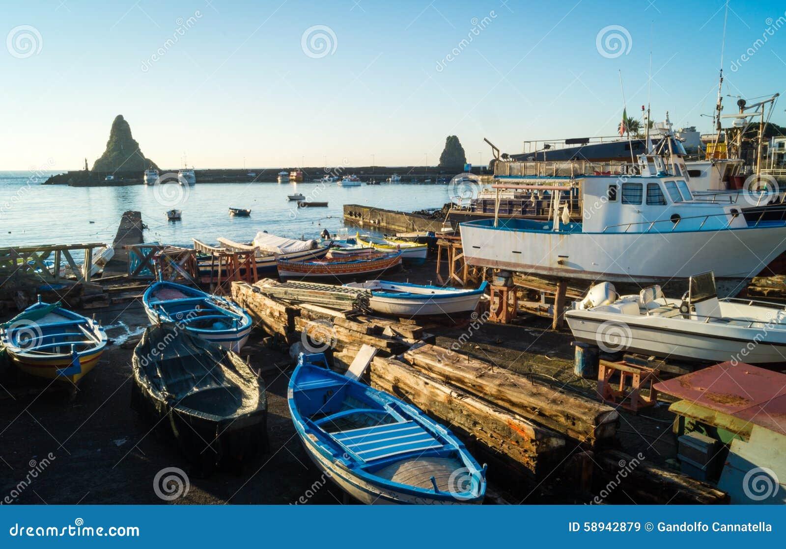 Acitrezza harbor with old boat