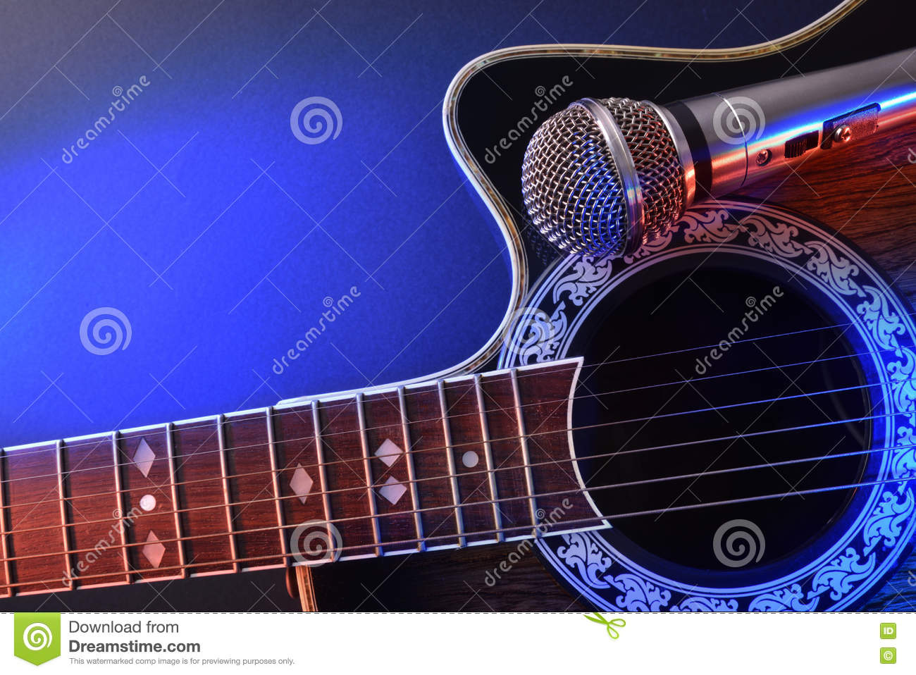 acoustic guitar and microphone isolated with red and blue lights stock photo image of music. Black Bedroom Furniture Sets. Home Design Ideas