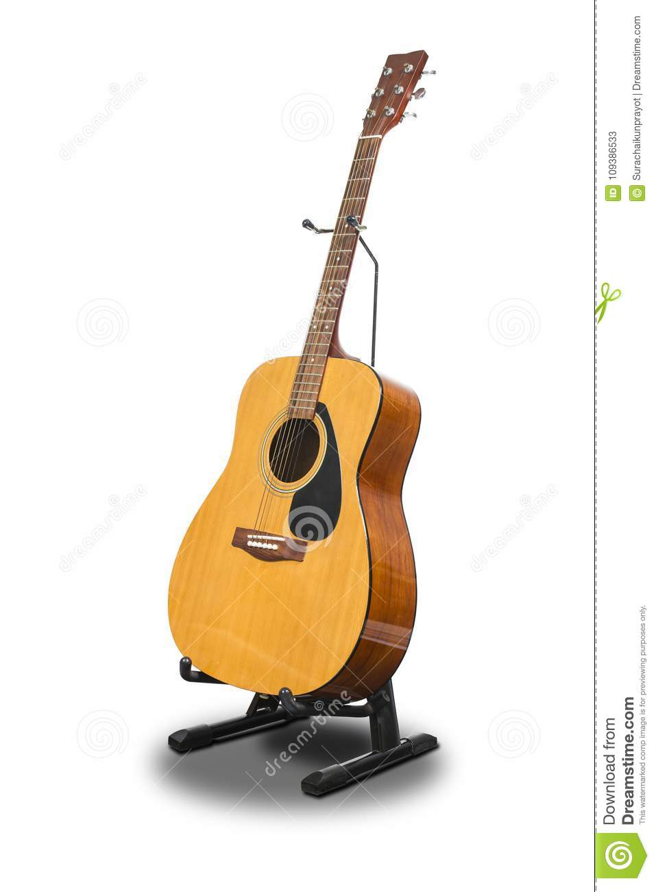 An Acoustic Guitar On A Stand Isolated On White Background Stock