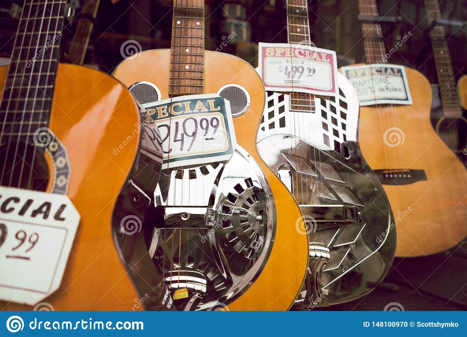Acoustic guitars on display in shop window