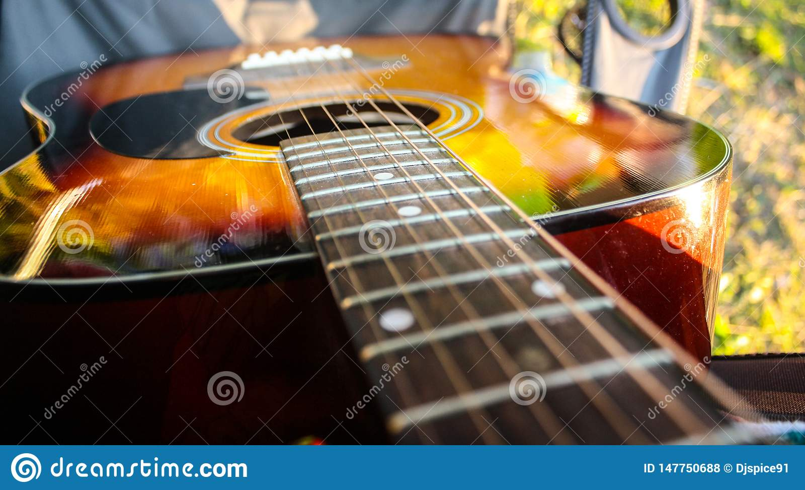 Acoustic orange guitar on camping