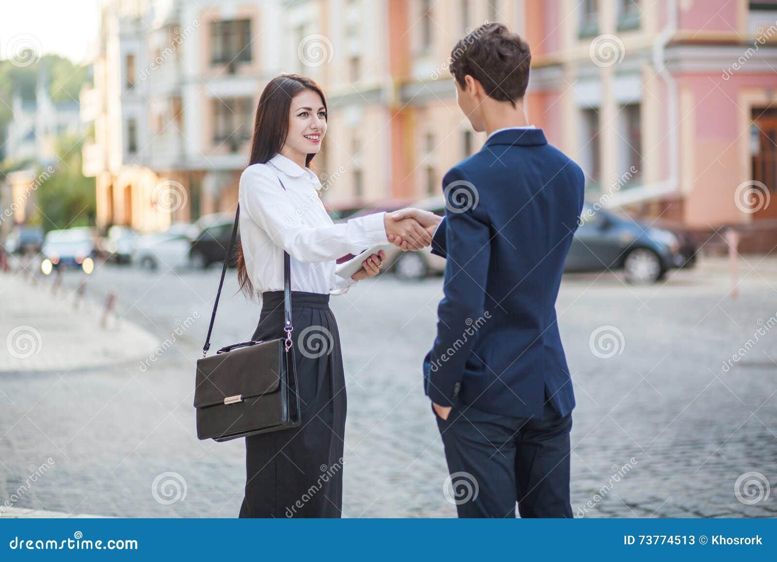 Acquaintance and communication of businessman, businesswoman
