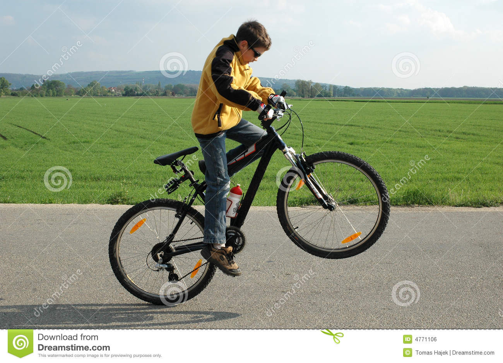Acrobat on bicycle
