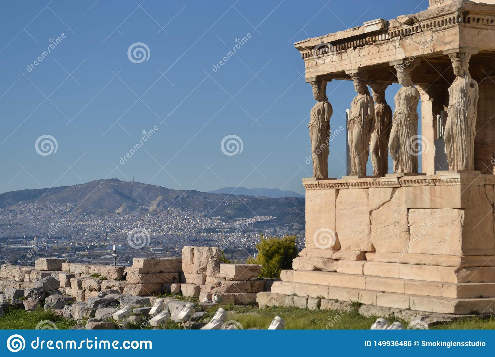 Acropolis, Athens, Karyatides with cityscape and blu sky