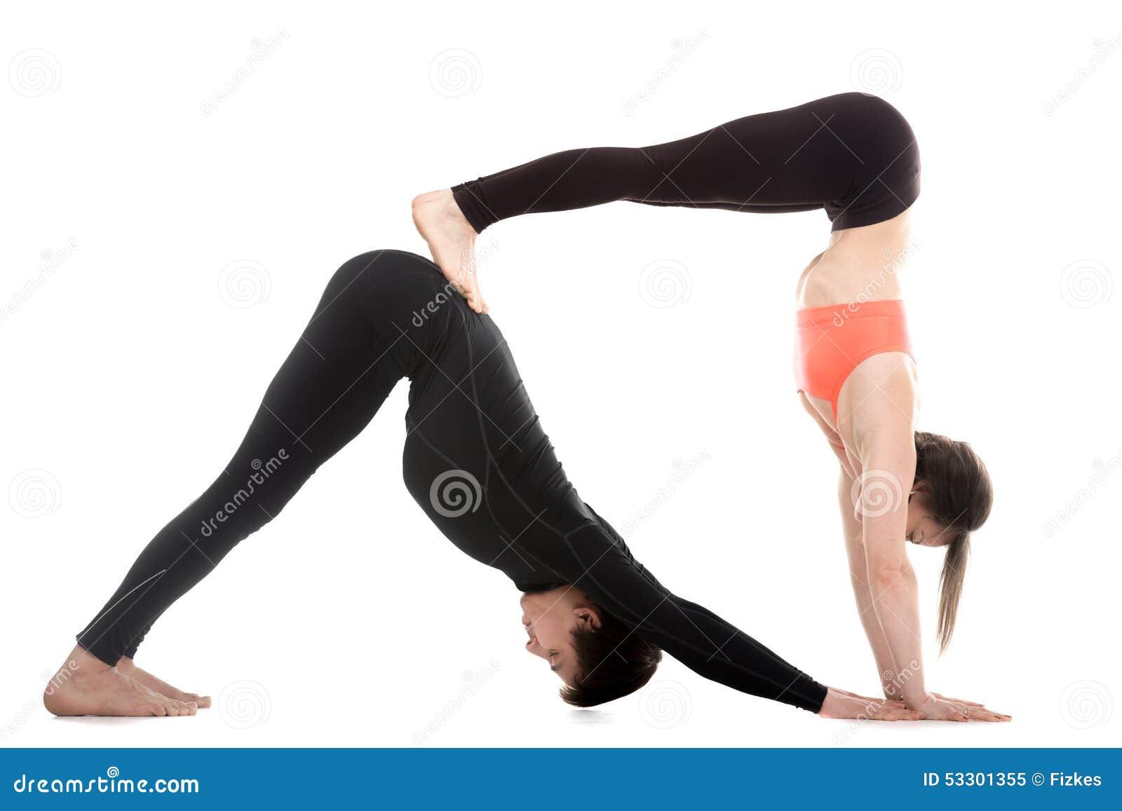 acroyoga pose orient e vers le bas de yoga de chien photo stock image 53301355. Black Bedroom Furniture Sets. Home Design Ideas