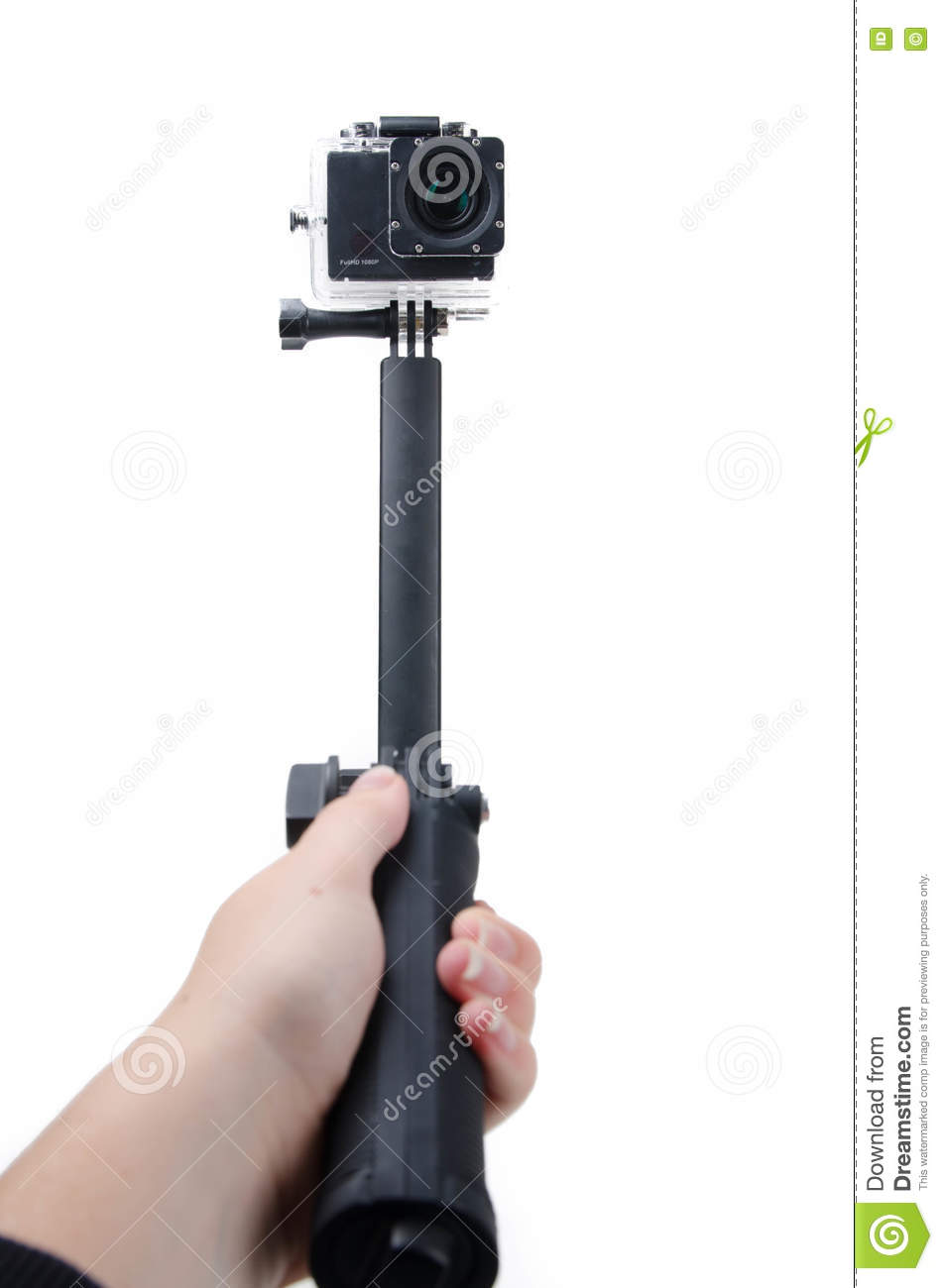 action camera selfie stick stock image image of hand 74983307. Black Bedroom Furniture Sets. Home Design Ideas