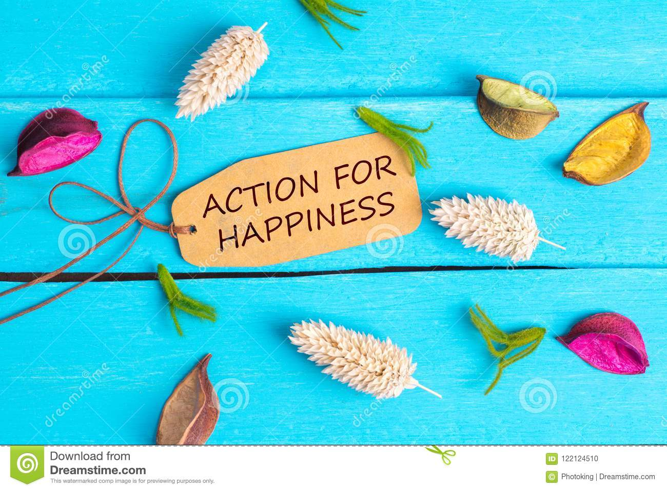 Action for happiness text on paper tag