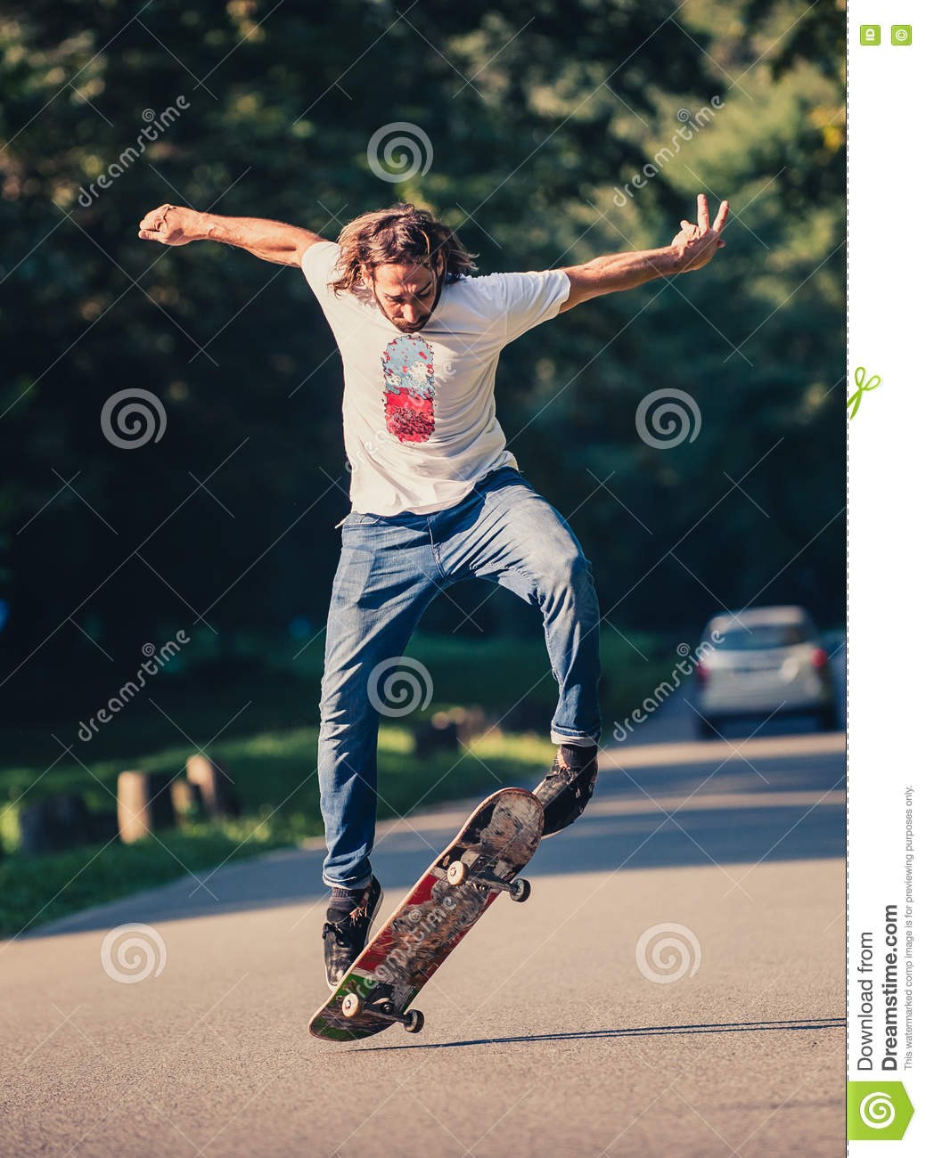 action shot of a skateboarder skating doing tricks and jumping