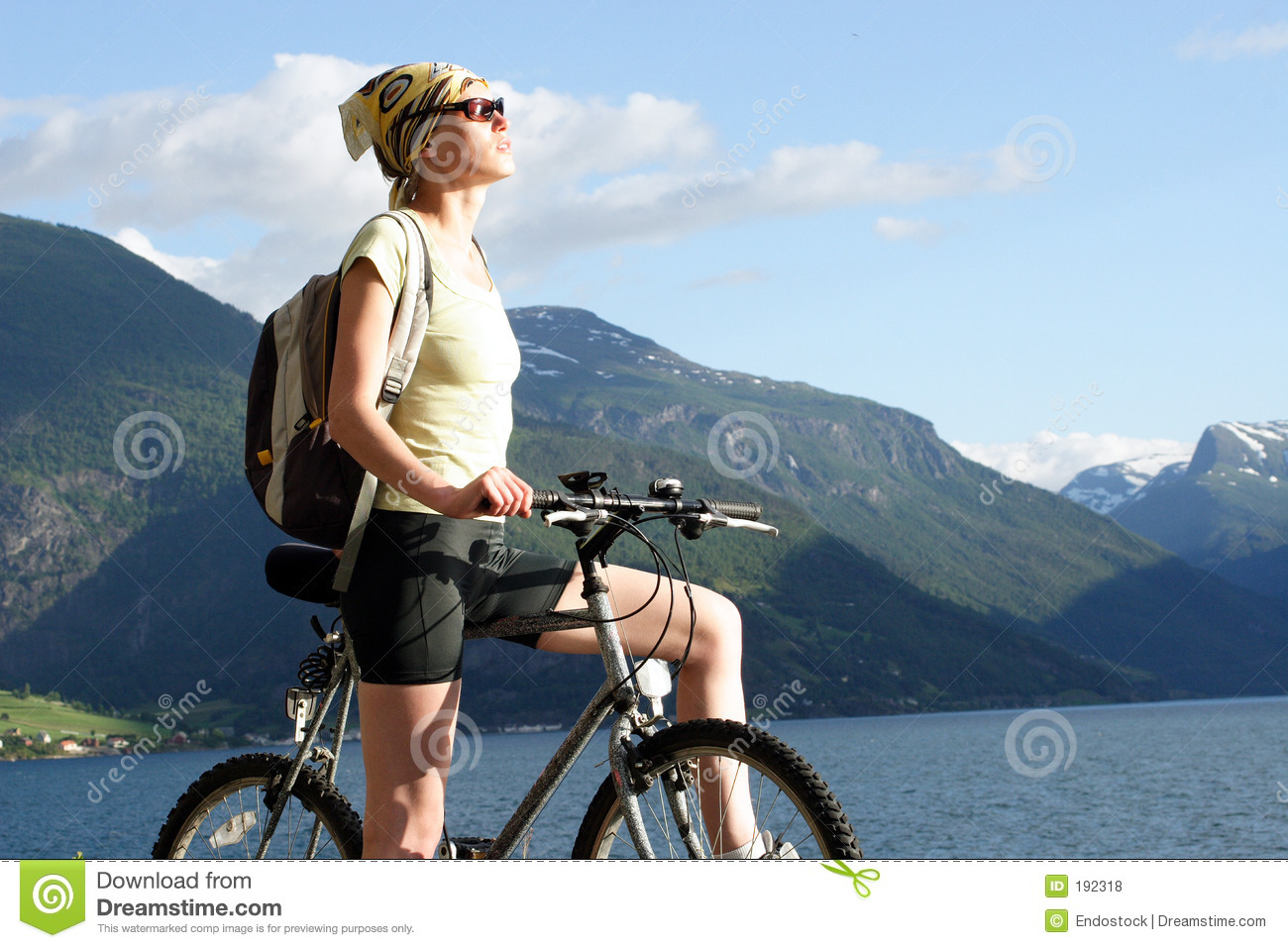 active 30ties woman on the bike in the mountains
