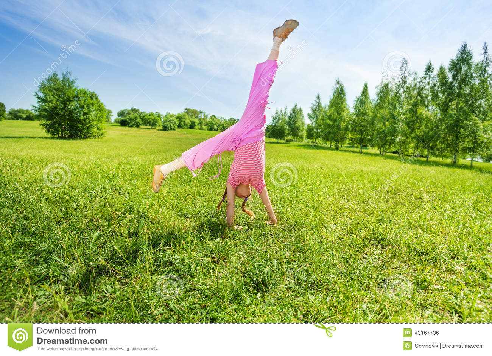 Active Girl Making Flip On Grass Outside Stock Photo ...