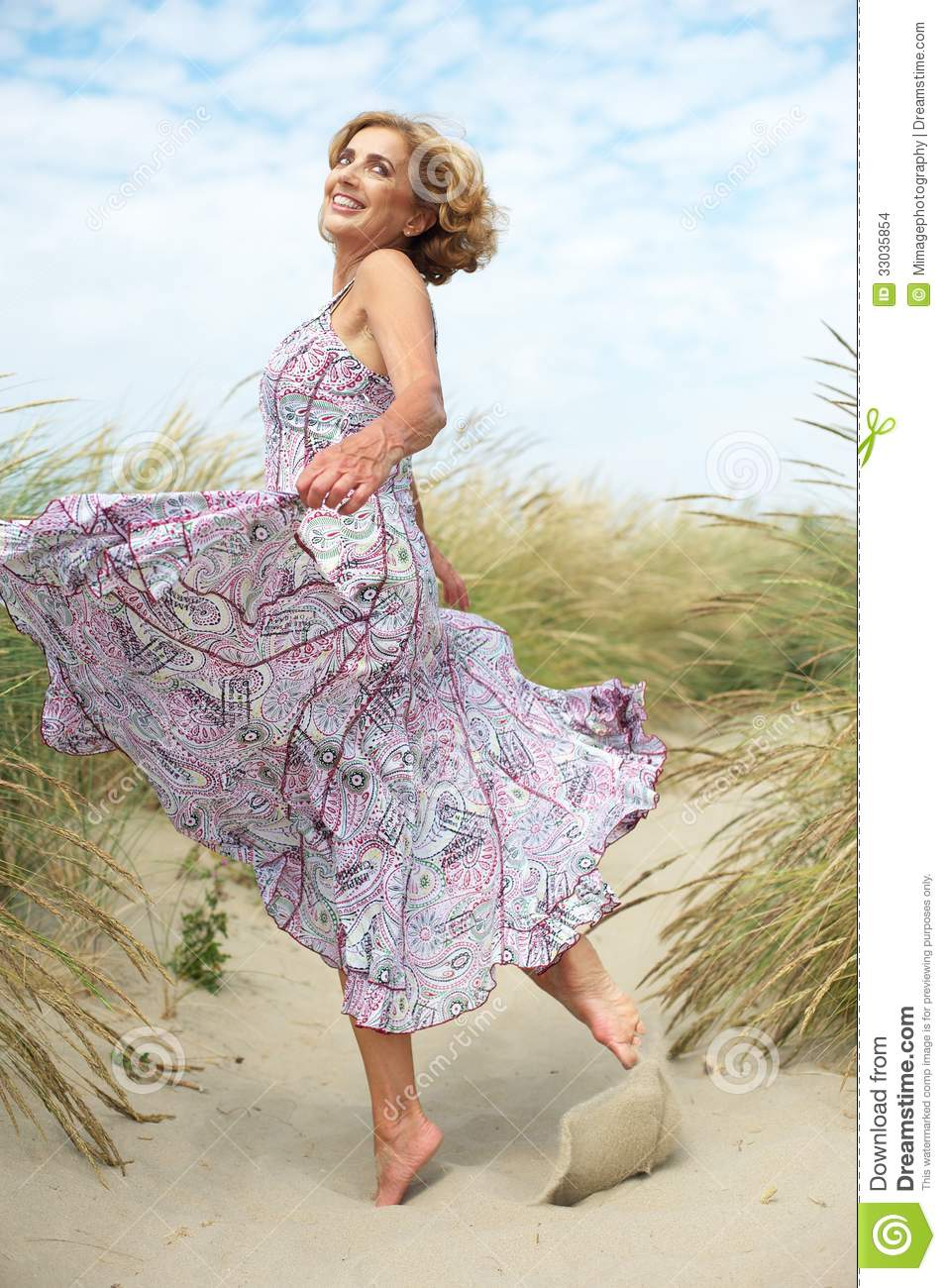 Active Older Woman Dancing At The Beach Stock Images ...