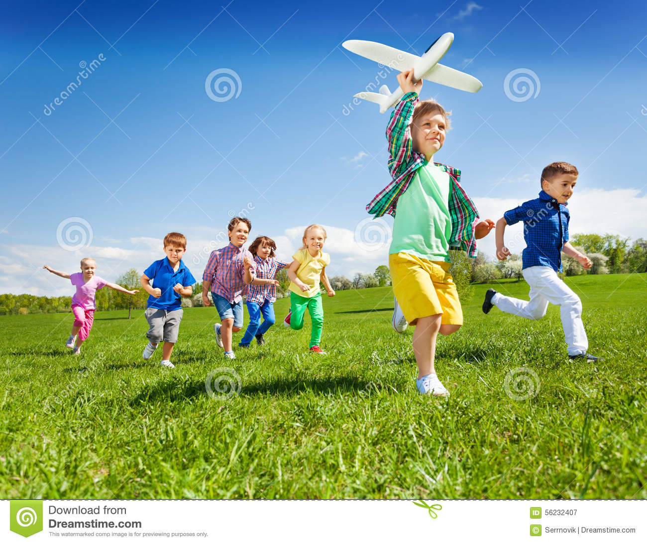 Toys For Active Boys : Active running kids with boy holding airplane toy stock