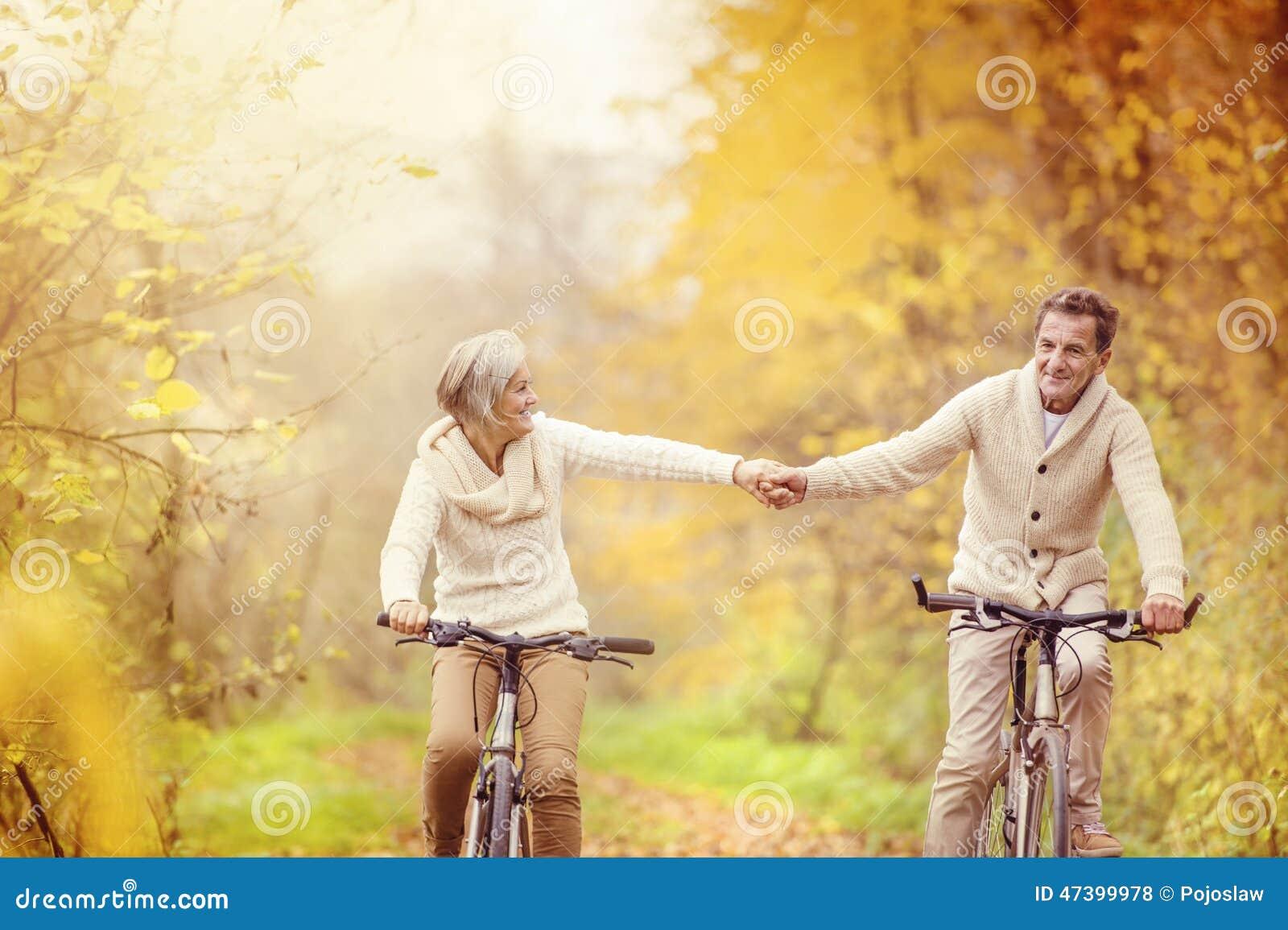 Active seniors riding bike