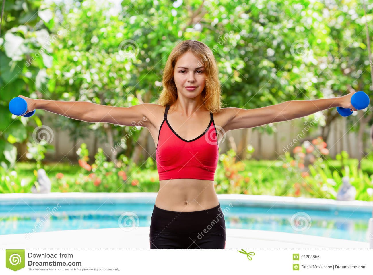 Active Sporty Woman Doing Morning Exercises With Dumbbells
