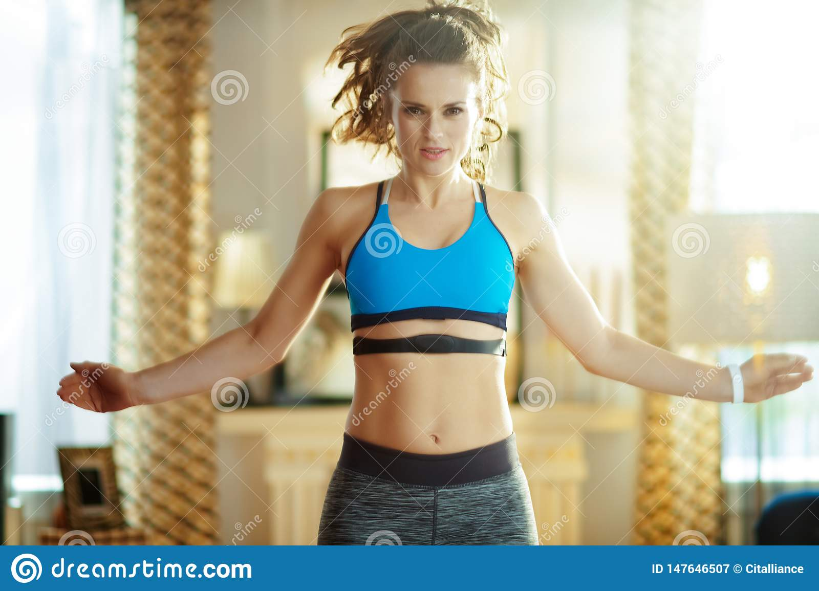 Active woman workout and using heart rate monitor