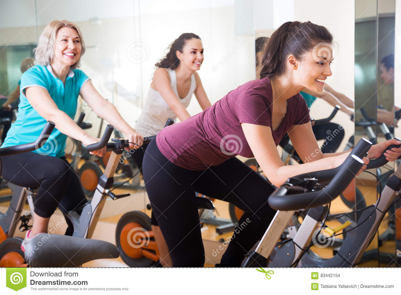 Active Women Of Different Age Training On Exercise Bikes Stock