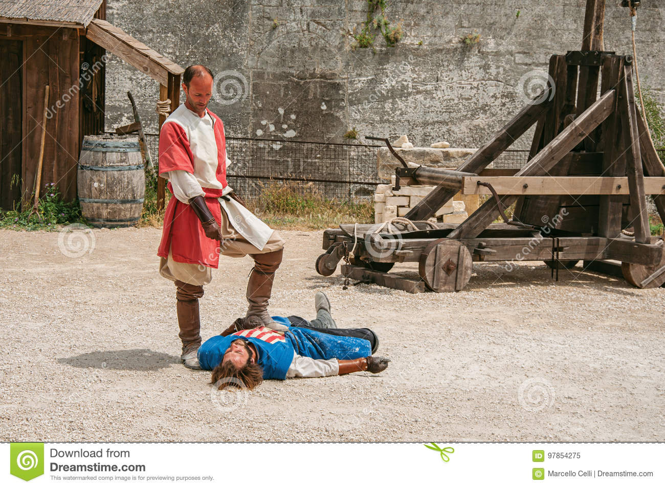 Actors doing a theatrical staging as medieval fighters in the castle of Baux-de-Provence.